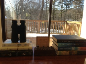 By my side, at the ready: books I love, binoculars, and nature beyond.