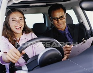 woman-driving-car_~x13474113